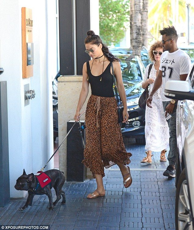 Shanina Shaik relaxing on Miami Beach with fiancé DJ Ruckus  | Daily Mail Online