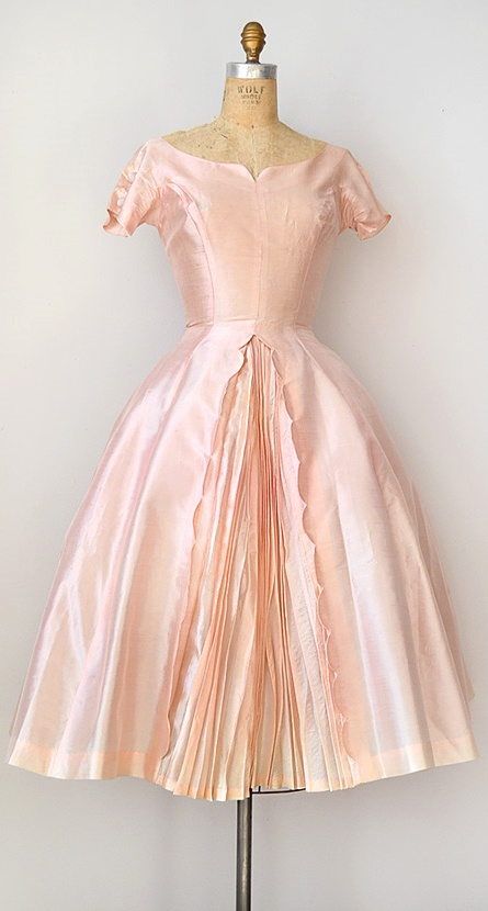 Gorgeous light pink dress. It reminds me of something a ballerina would wear. :)