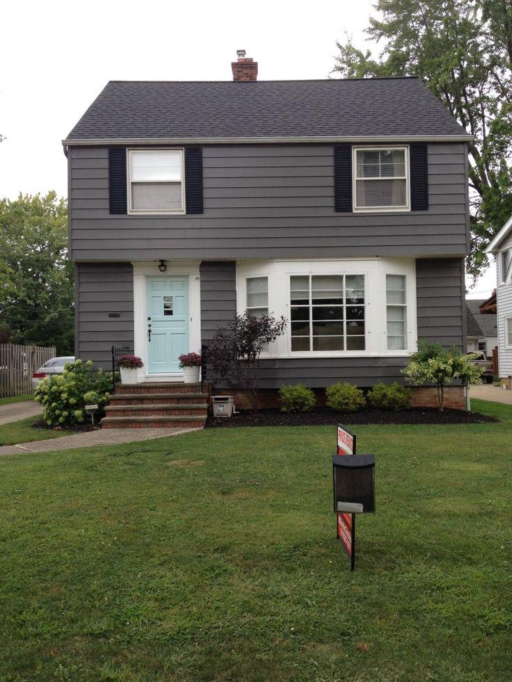 gray house white trim black shutters  exterior paint
