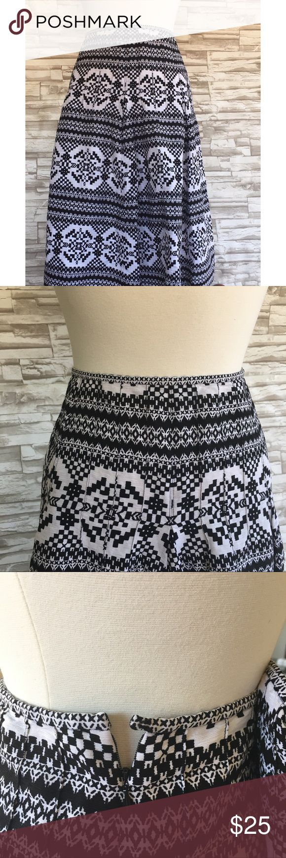 "💜Nine West Skirt Gorgeous!! Black and white A-line skirt from Nine West. Plus size 16. 70% silk 30% linen. Dry clean only. Pleated around the hips. Hook and eye with a zipper closure on the side. Worn only once! Made in China. LAYING FLAT MEASUREMENTS: waist 18"" length 26"" Nine West Skirts A-Line or Full"
