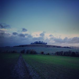 The Wittenham Clumps, and the skies turning darker (by Charlotte Cooper)
