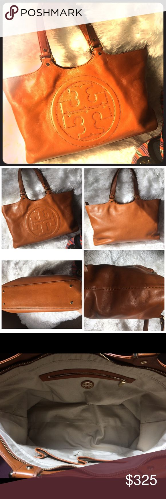 Tory Burch Bombe Burch Tote This is in excellent condition! Two minor imperfections shown in the last two photos (one handle small dye transfer, and bottom corner small scuff mark) do not impact the beauty, nor function of this classy must have piece! Leather tote in luggage color! Super clean inside and out! Price firm.. all offers will be negotiated through the offer option, no trades! Large!! Will hold your Mac Pro and other small laptops! Comes with detached tag, no duster Tory Burch…