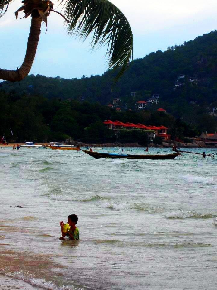 A local boy relaxing in the sea, Koh Tao, Thailand.