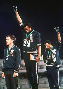 1968 Olympics: Tommie Smith (center) and John Carlos (right) showing the Black Power salute in the 1968 Summer Olympics while Silver medalist Peter Norman (left) wears an OPHR badge to show his support for the two Americans