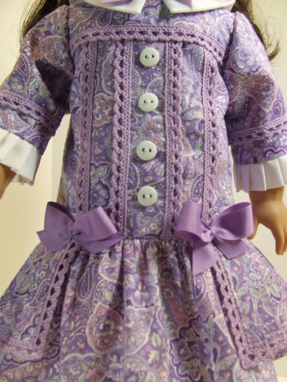 """Lavender Paisley for Samantha or Rebecca by agseamstress on Etsy. Close up of bodice details of """"Buttons and Bows"""" in a pretty paisley cotton fabric. The bodice is lined in purple cotton and has rows of cotton crochet lace in vertical rows flanking white decorative buttons. Little grosgrain bows decorate the dropped waistline of the double skirt. Marilyn added a white collar and white pleats on the sleeves. This is modified from a Vogue pattern by Teresa Layman."""