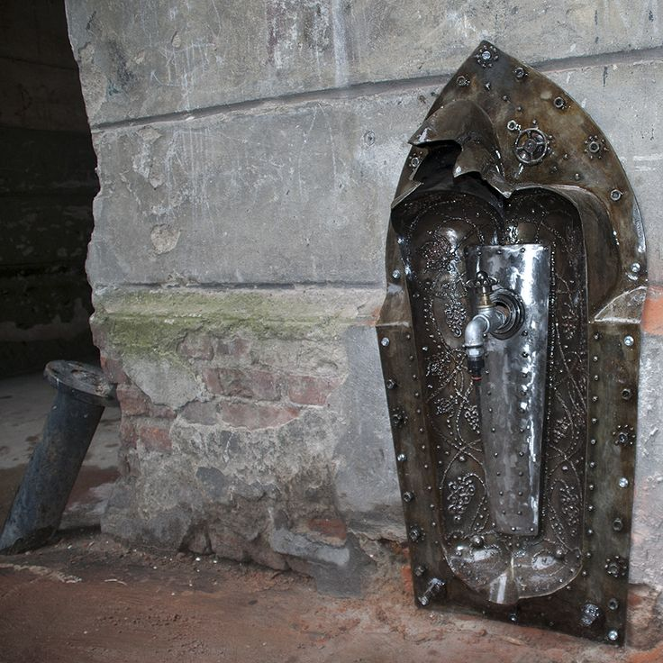 Metal watering place welded from scrap. Surindustrialle Gallery in Lodz / Poland. Scrap metal art, welding applied art and jewellery