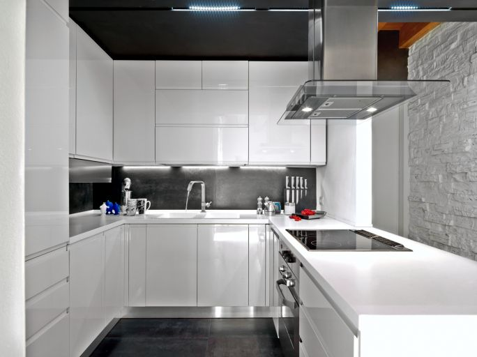 Picture of white modern kitchen cabinets with black back splash and floor