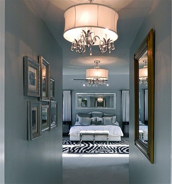 Normally not into really chic decor like this but I'm loving the gray with silver frames. HAVE to have a gray wall with silver frames somewhere ...