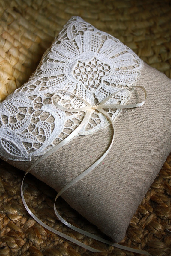 What a great idea for some handmade lace, or some Hardanger, or any other stitched piece that may have been damaged...  Just cut away the damaged part, find some beautiful backing for a pillow, and away you go!  I think I have some things in my stash......