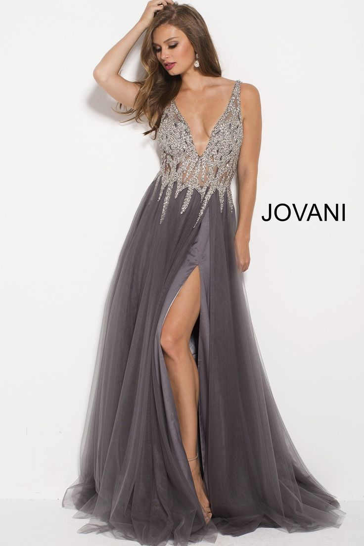 You're as cool as ice in Jovani 54873. This glamorous gown features a sheer illusion bodice, covered in decadent jewels, that add an icicle effect to the full, pleated, A-line, tulle skirt. The bodice has a plunging V-neckline, tank straps, and an open, V-shaped back. The flowy skirt has a hidden side slit, and lovely sweep train. Get a breath of fresh air in this gown at a pageant, prom, or charity ball.