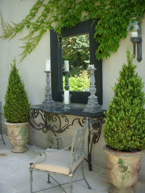 Enhance your landscape with container gardening, adding shrubs to planters give your yard depth and height. Love the outdoor vignette