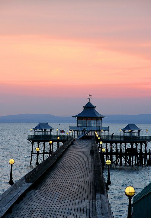 """Clevedon Pier is a seaside pier in the town of Clevedon, Somerset on the English side of the Severn Estuary. It has been described by Sir John Betjeman, as """"the most beautiful pier in England"""" and was designated a Grade I listed building in 2001."""