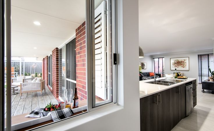 Convenient servery window from kitchen to alfresco area