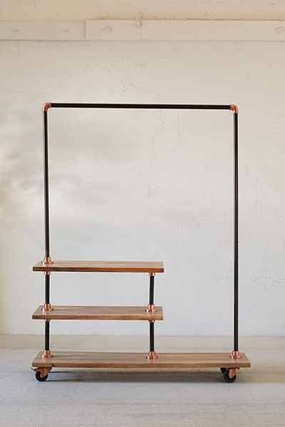 4040 Locust Industrial storage rack. Black steel tubing, copper accents, and mangowood shelves.