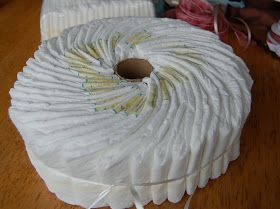 Diaper cake DIY- no rolling and rubber banding individual diapers.