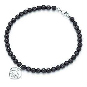 Tiffany & Co. | Item | Return to Tiffany™ mini heart tag in silver on a black onyx bead bracelet. | United States