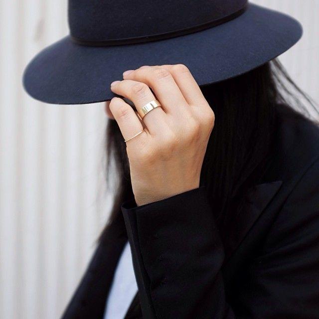 black hat, subtle jewelry