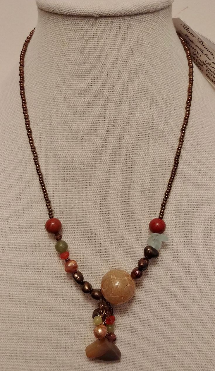 Mixed semi-precious stones with fresh water pearls and fine Czech glass.