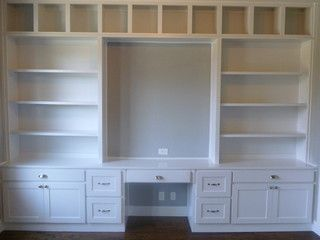 In our office, have the window in the center, flanked by shelves/cabinets on both sides, and bench seat level with window sill Study Built-ins- Coronado - home office - dallas - by JLD Custom Homes