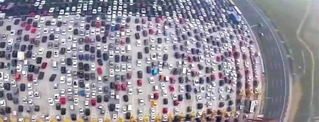 A Beijing, China highway had a massive 50 lane traffic jam as people traveled back home from the Golden Week.