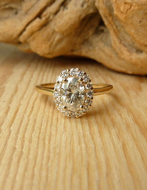 Oval Moissanite and Diamond Halo Ring on Etsy- Love Kate Szabone! She made my wedding band and will make my new engagement ring someday (since I don't wear my original)