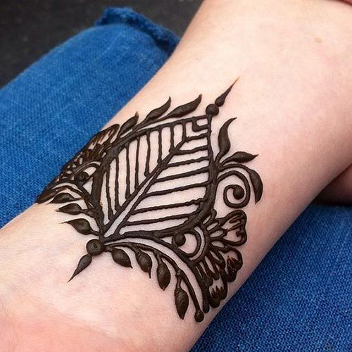 Simple feather with floral henna design