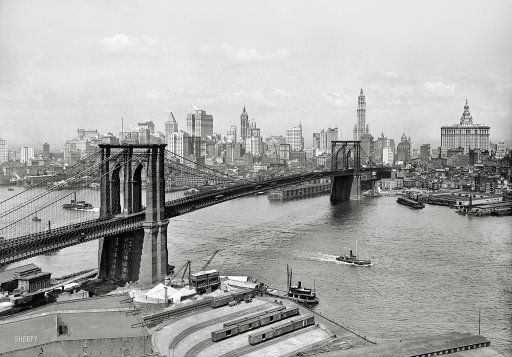 """New York circa 1915. """"Brooklyn Bridge, East River and skyline."""" The Woolworth Building stars in this Lower Manhattan view, with the Singer, Bankers Trust, Hudson Terminal, Municipal and Park Row buildings as understudies. 5x7 inch dry plate glass negative, Detroit Publishing Company."""