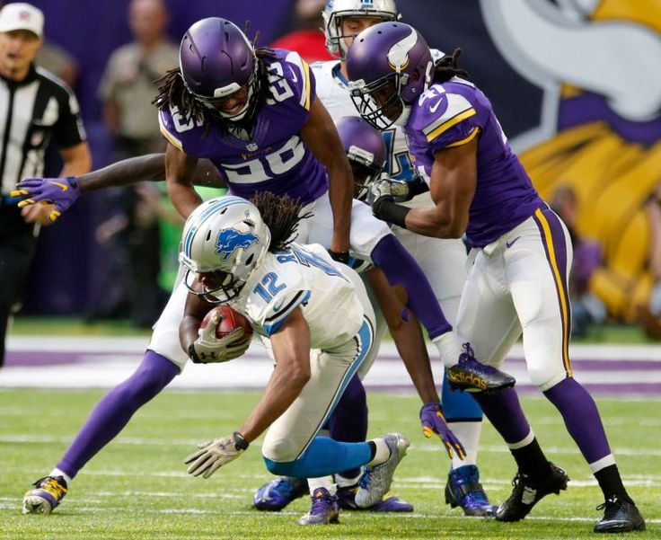 Lions vs. Vikings:  22-16, Lions  -  November 6, 2016  -     Detroit Lions wide receiver Andre Roberts (12) is tackled by Minnesota Vikings defenders Trae Waynes (26) and Anthony Harris (41) during the first half of an NFL football game Sunday, Nov. 6, 2016, in Minneapolis.