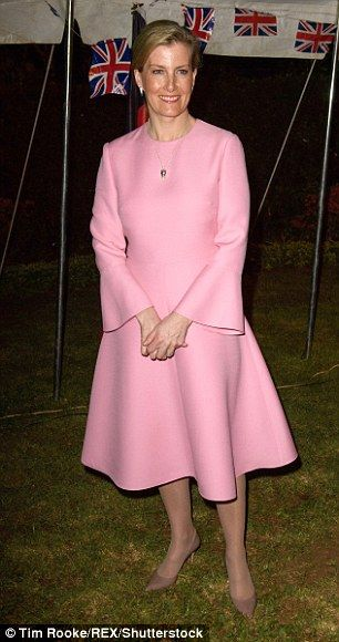 Sophie Wessex, 52, stepped out in a pretty pink ensemble today as she attended a reception at the British High Commissioner's residence in Lilongwe, Malawi.