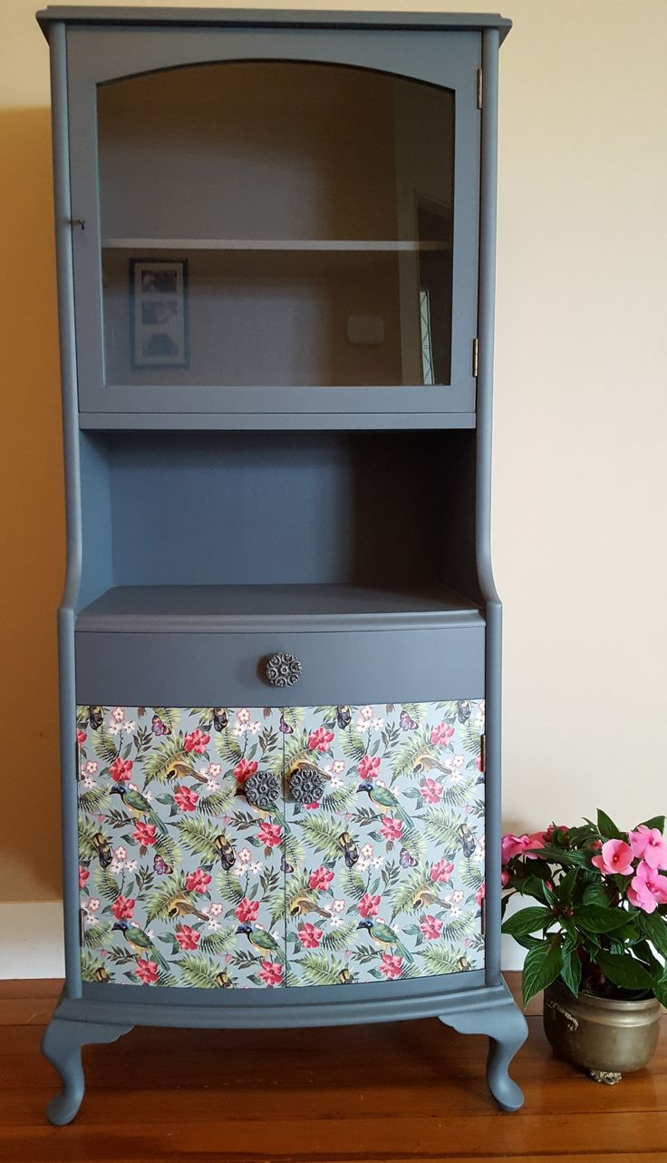 Superb decoupaged cabinet with lockable glass fronted display case. Pretty queen Anne feet.