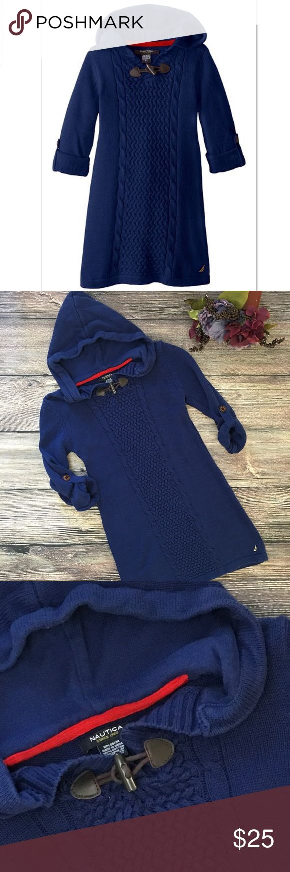 "Nautica Hooded knit Sweater Dress Girls 6x Dress your little lady up this winter in this stylish hooded sweater dress from Nautica. With roll tab sleeves, front toggle closure, interesting front knit pattern and Nautica embroidery, this 100% cotton deep blue dress is sure to be one of her favorites throughout the season and beyond. Approx 14"" bust/pit to pit, 25 1/2"" length when laid flat. Deep blue color, excellent condition, size 6x Girls. (C4) offers warmly received. Nautica Dresses"