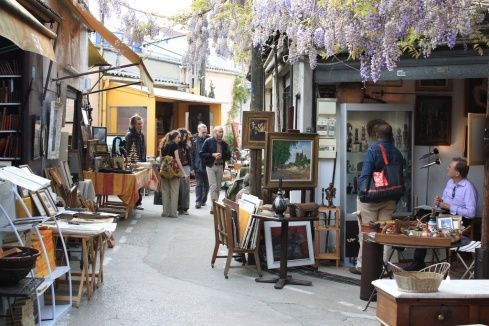 Les Puces de Saint-Ouen flea market.    Its open 9am - 6pm Saturday, 10am to 6pm Sunday. There are stalls on Monday too, but the weekend is best.    Take the métro to Porte de Clignancourt on Line 4 and follow the crowds towards the large concrete overpass.