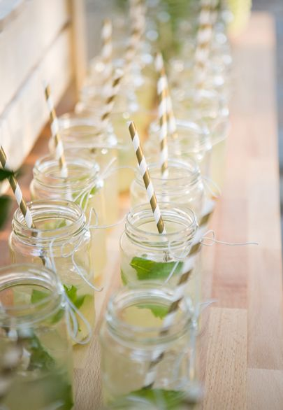 Mini mason jars with striped paper straws on the lemonade stand- Mitheo Events | Concept Events Styling