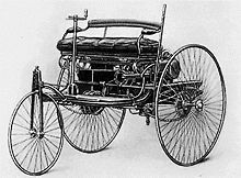 A photograph of the original Benz Patent-Motorwagen, first built in 1885 and awarded the patent for the concept
