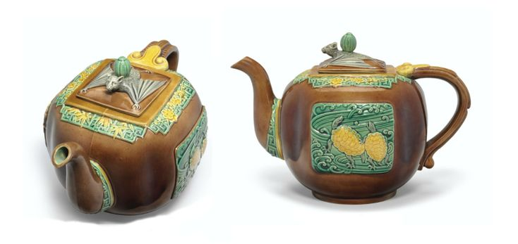 MINTONS MAJOLICA TEAPOT AND COVER DATE CYPHER FOR 1879, IMPRESSED UPPERCASE MARK AND CYPHER, THE DESIGN POSSIBLY BY CHRISTOPHER DRESSER In the Chinoiserie taste, one side molded with turtles among whirling waves, the other with a crane holding peaches in its beak, pine, prunus and bamboo at the rim, the finial as a bat