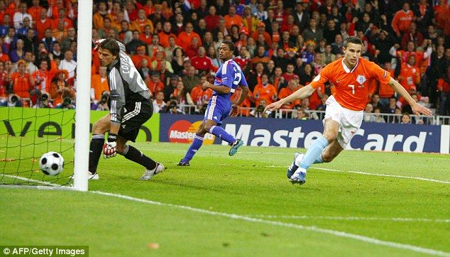 Robin van Persie (right) wheels away after scoring past French goalkeeper Gregory Coupet