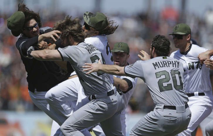 Basebrawl! Harper, Strickland punch away, Nats-Giants fight  -  May 29, 2017:     Washington Nationals' Daniel Murphy (20) tries to restrain teammate Bryce Harper (34) after  Harper charged San Francisco Giants' Hunter Strickland after being hit with a pitch in the  eighth inning of a baseball game Monday, May 29, 2017, in San Francisco. (AP Photo/Ben  Margot)