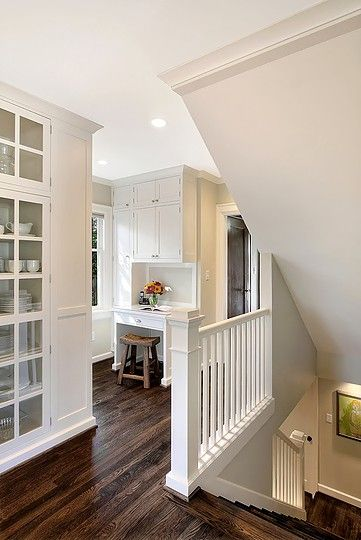 love this little alcove- laptop station to connect kitchen and garage/mudroom with stairs to basement