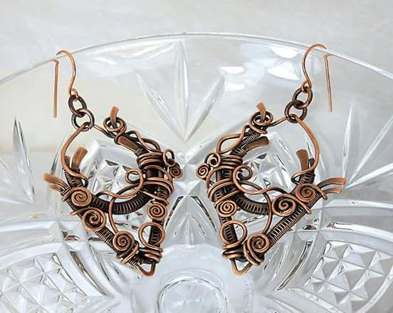 "Earrings by Donna Gomes - These earrings feature intricate wire-woven and wrapped pieces in solid copper, deeply oxidized, and polished to emphasize the weave and design. Measure 2.75"" long. Modified & embellished from pattern by Susanna Thompson."