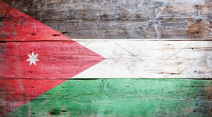 #Flag of Jordan  Flag of Jordan painted on grungy wood plank background