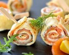 Roulés d'omelette au saumon fumé, cream cheese et roquette : http://www.cuisineaz.com/recettes/roules-d-omelette-au-saumon-fume-cream-cheese-et-roquette-86614.aspx