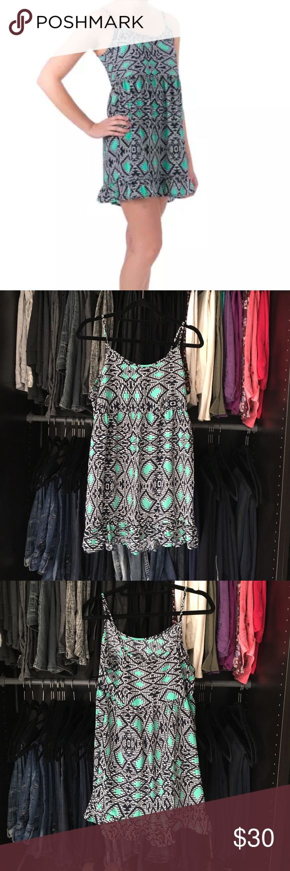 """Aztec Summer Dress The fun Aztec print we can't get enough of comes to you in a super soft navy, white, and teal dress.  Adjustable straps. Flowy and comfy. 100% poly. XS- 33""""L, 17.5""""B, 16""""W, S- 34.5""""L, 19""""B, 16.5""""W, L- 34.25""""L, 19""""B, 16""""W.  Price firm unless bundled.  ✅AVAILABLE 🚫TRADES 🚫HOLDS 💰SAVE 15% 3+ ITEMS 🆓 ITEMS  AVAILABLE 🐾 CRUELTY FREE one clothing Dresses"""