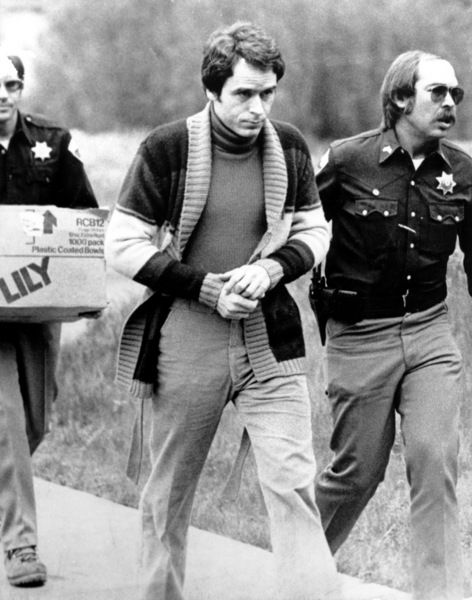 Convicted kidnapper Ted Bundy is led into the Pitkin County courthouse by Deputy Peter Murphy, left, and Rick Kralicek for a hearing in Aspen, Colo, by Mark Levy/AP, June, 1977