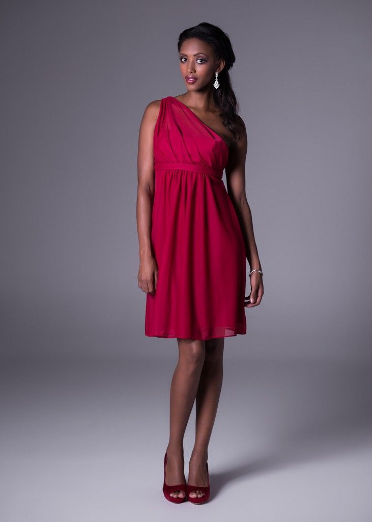 Is your wedding colour scheme red? This striking but elegant asymmetrical knee-length dress has a rouged shoulder, and it's available in six colour variations to match your #wedding theme. Click to View the Colours and Price. Available at Bride&co