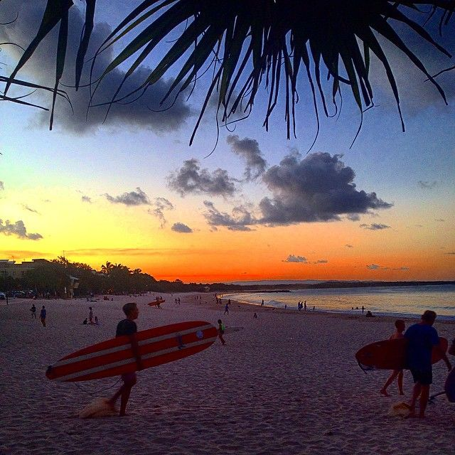 What a colourful backdrop for a summer surf at Noosa Main Beach!