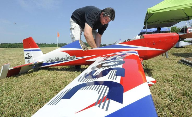 Mike Wahlers of Sedgewickville, Missouri, prepares his Extra 330SC model airplane for flight at the Southeast Missouri Modelers Association's Fly-Low-In event Saturday at Galaxy Park. Fred Lynch