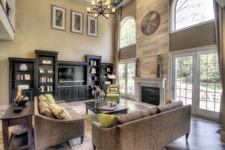 Two story great room with windows doors beside fireplace for Great room decorating ideas