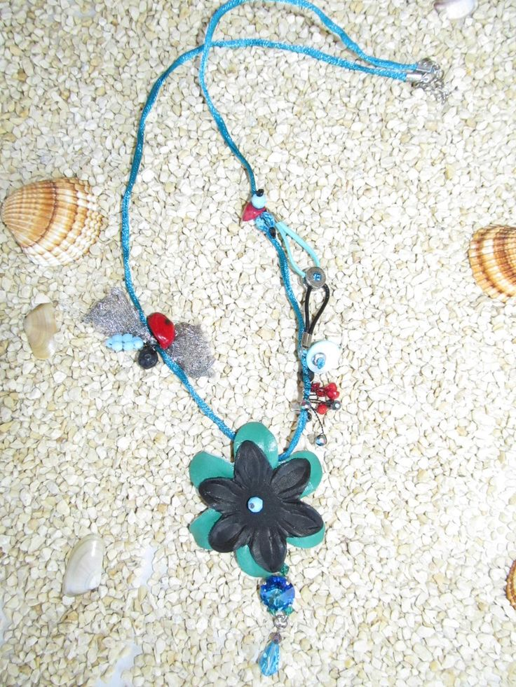 Handmade leather necklace (1 pc)  Made with leather flowers, metalized teal cord, metals with teal crystals, leather cords, gemstones and glass beads.