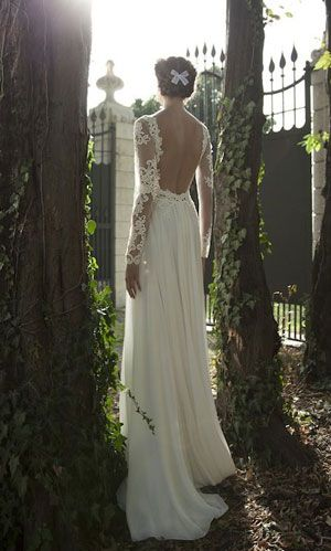 I love the lace sleeves and the open back... In the event I want my tatts covered up on my big day, I would probably go with something like this.