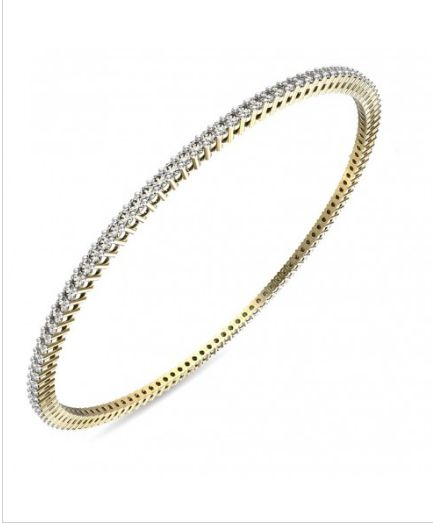 Chiming Bangle - This latest designer bangle has a classy and spellbounding design that has a unique appeal. This diamond bangle for women is not just ideal for the young working woman but also middle aged homemakers. Sold exclusively on our online jewellery store, this is a must have in your jewellery collection.